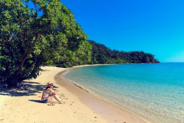 Female sitting at the beach in Fiji