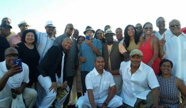 Present and former jocks from KJLH. I was asked why I was not on stage. It was because I had just arrived when they called everybody and my big ass was not going to fall in the sand trying to run up there to take a pic.