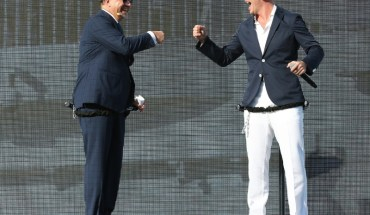 "Frank Del Rio and Pitbull celebrate with onstage ""fist bump"" at the Norwegian Escape christening ceremony. (PRNewsFoto/Norwegian Cruise Line)"