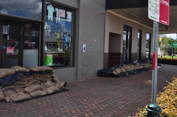 Businesses and homes in Forbes have prepared for flooding by blocking entrances with sandbags.