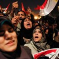 Egyptian women celebrate the news of the resignation of President Hosni Mubarak, who handed control of the country to the military, at night in Tahrir Square in downtown Cairo, Egypt Friday, Feb. 11, 2011. Credit: Ruba Obaid/rab00sh on flickr