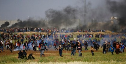Teargas canisters fired by Israeli troops falls down at Palestinians during a demonstration near the Gaza Strip border with Israel, in eastern Gaza City, Friday, March 30, 2018.  Palestinians clashed with Israeli troops along the Gaza border Friday morning as thousands gathered there for mass sit-ins led by the militant Islamic group Hamas that rules the territory. (AP Photo/Hatem Moussa)