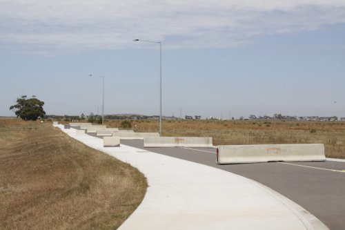The completed access road, with concrete traffic barriers preventing local hoons from using it