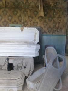 """The coffin """"plate"""" on the right allows the face to be visible for viewing, while the body stays hidden."""