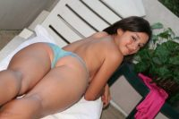 Young looking brunette Summer ditches satin lingerie to model naked