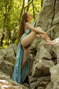 Teen princess in long dress Milena D teases with her hairy pussy in the woods