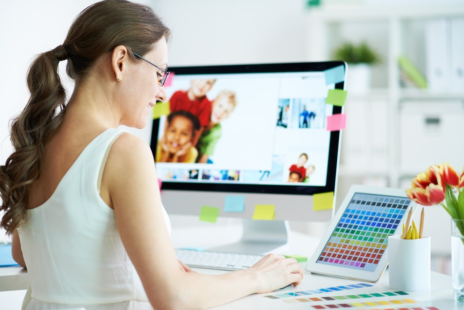 Portrait of pretty female designer working with colors at home