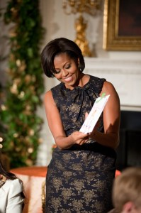 First Lady Michelle Obama shows off a card during a craft demonstration in the State Dining Room of the White House, Dec. 1, 2010. The FIrst Lady visited three creative stations where children of military personnel worked on different projects. (Official White House Photo by Lawrence Jackson)