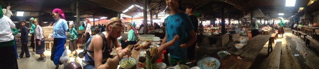 a traveler takes lunch at meo vac market