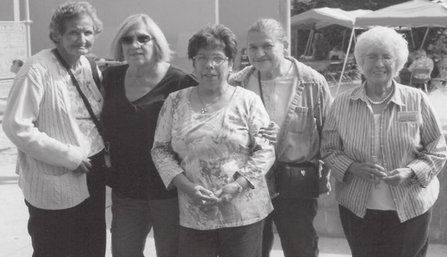 Lupe Laguna Esparza is 2nd from left in this 2012 reunion picture of softball players in Santa Ana, California. (Photo courtesy of Richard A. Santillán from his book Mexican American Baseball in the Central Coast)