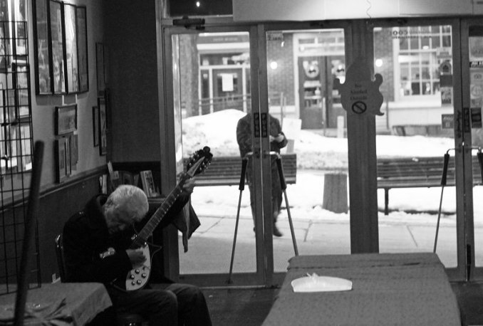 The Searchers Mike Pender tunes up in the lobby of the Kent Stage, Kent, OH. Photo by Daniel Coston.