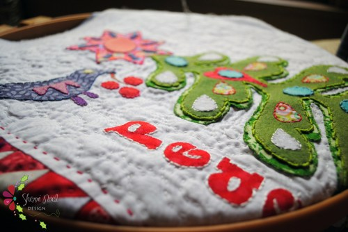 mini christmas quilt with big stitch hand quilting