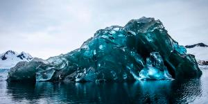 An overturned ice-burg is remarkably blue: far bluer than an Ice sculpture. I claim clathrates are the reason.
