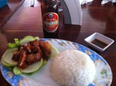 My first meal (Lok Lak – a peppery, tomatoey beef with a side of pepper sauce) and Angkor beer.