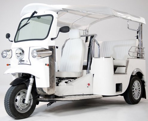 electrictuktuk Electric Tuk Tuk comes to Europe   doors? we dont need no stinkin doors...