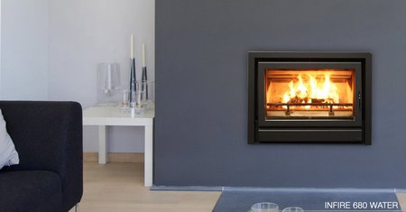 New energy saving woodstove captures and uses heat for water