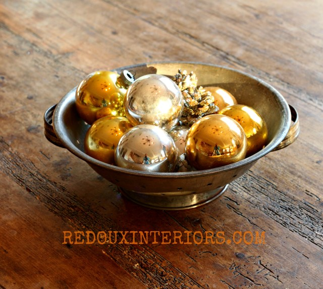Colander filled with ornaments Redouxinteriors