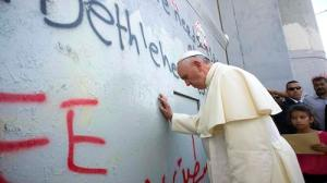 Pope Francis touches the Apartheid Wall in Bethlehem
