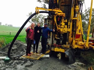John Geber, Michelle Geber and  Neville Rowe (Winemaker) celebrate striking water.