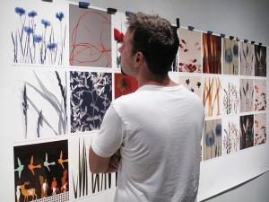 Artist Ethan Jantzer inspecting print color prior to the reknowned Cherry Creek Arts Festival