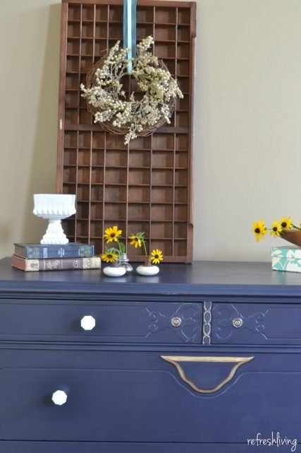 navy blue dresser with gold
