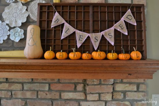 fall mantel with pumpkins