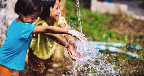 children playing with water