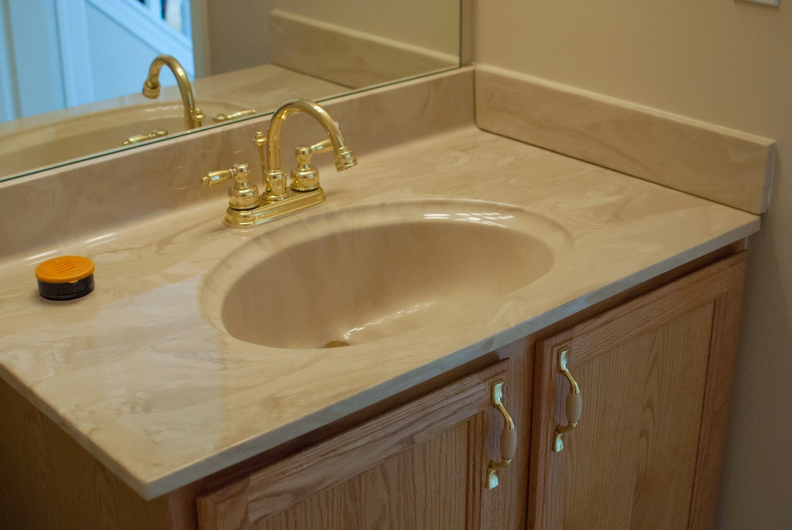 Vanity sink and countertop before i m flying south featured on remodelaholic