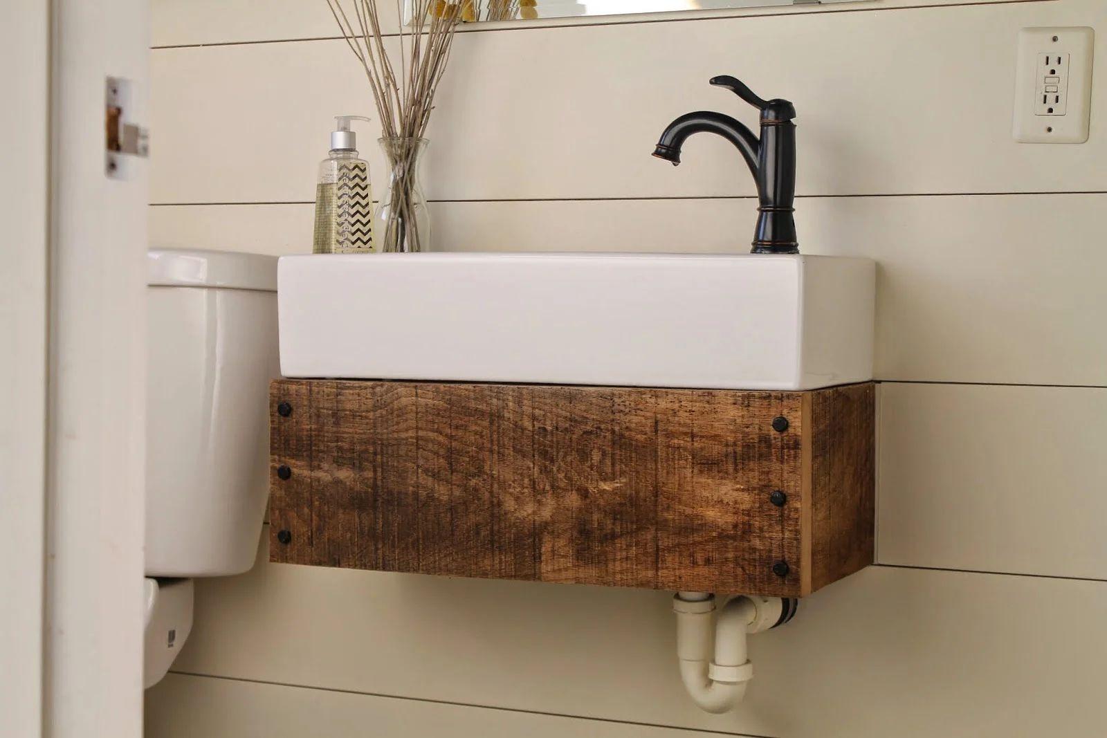 Diy floating reclaimed wood vanity with ikea sink girl meets carpenter featured on remodelaholic