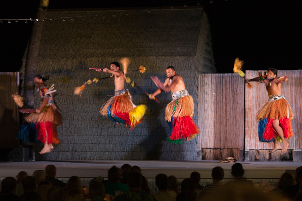 Jumping gentlemen at the luau.