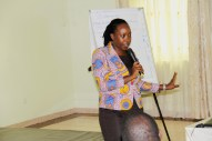 Catherine Mercy from Save the Children giving guidelines for group discussions