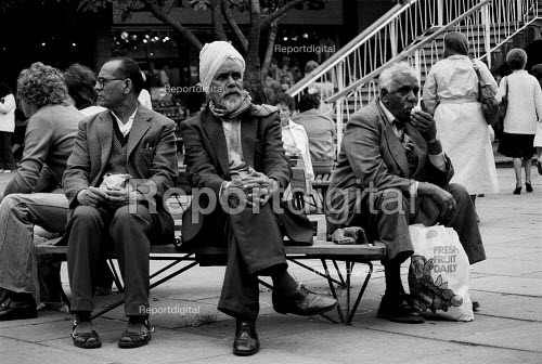 Report Digital Asian Men Sitting In Coventry Shopping