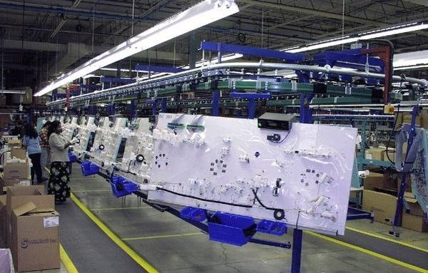 The wire harness paced assembly conveyor (often referred to as a