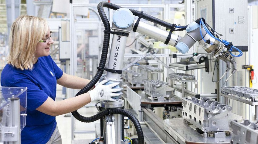2 A robot arm helps make engine components at a Volkswagen factory