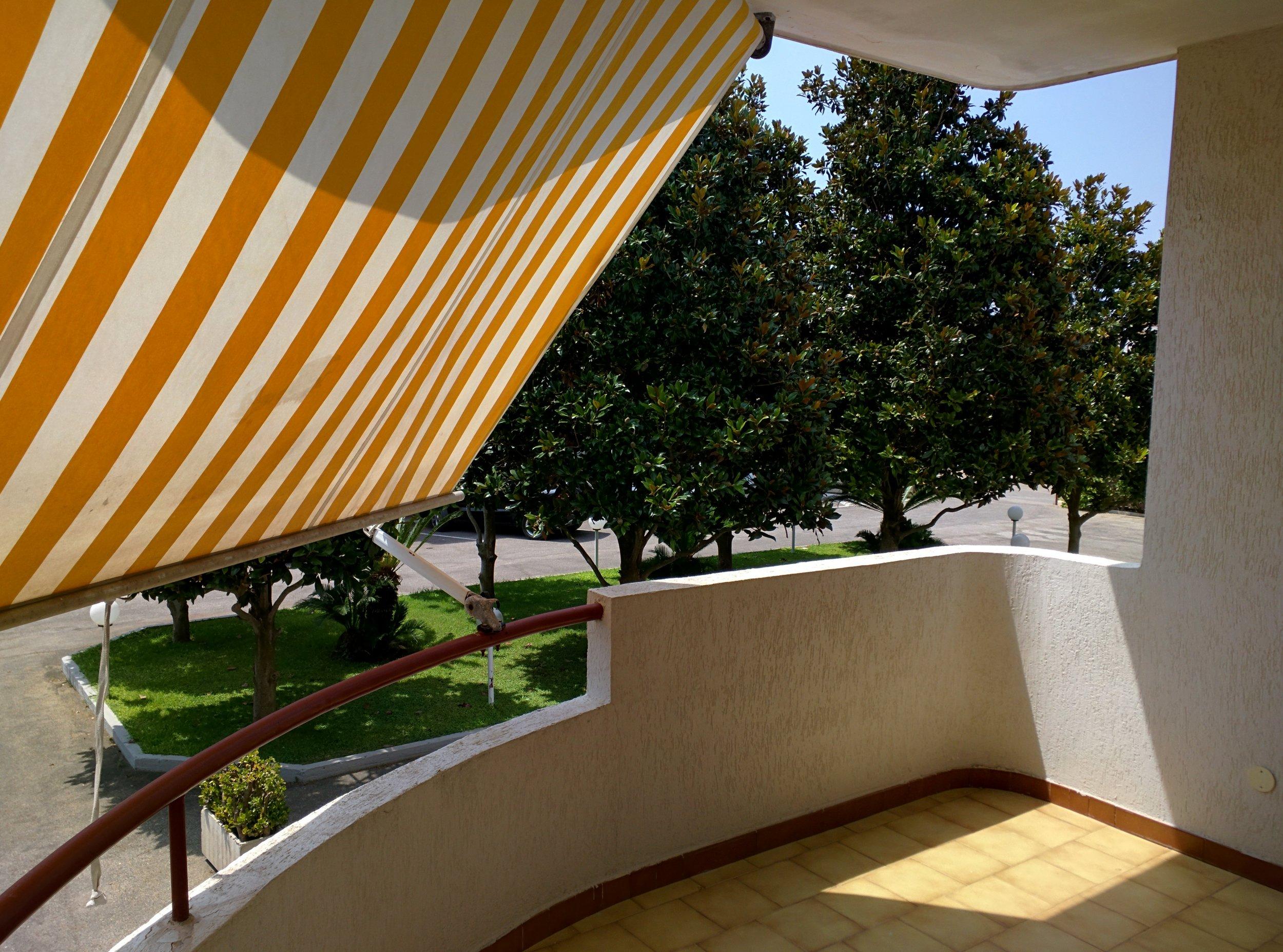 Terrazzo abitabile con tenda da sole