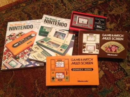 Coffee table reading, original CIB Donkey Kong and Donkey Kong JR Game&Watch, Club Nintendo re-issue Ball Game&Watch