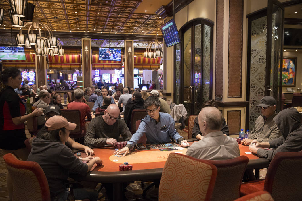 Gamblers try their hand in the High Stakes Poker Room on Tuesday