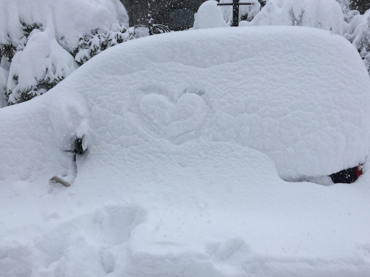 My car, the morning after I parked it. Who left the heart?