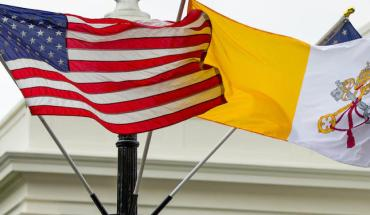 The Flag of Vatican City flies next to American flags outside of the West Wing of the White House on Monday ahead of Pope Francis' arrival.