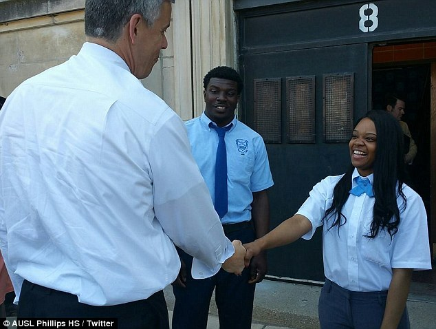 Great honor: Trameka took to Facebook to share this photo of herself shaking hands with US Secretary of Education Arne Duncan