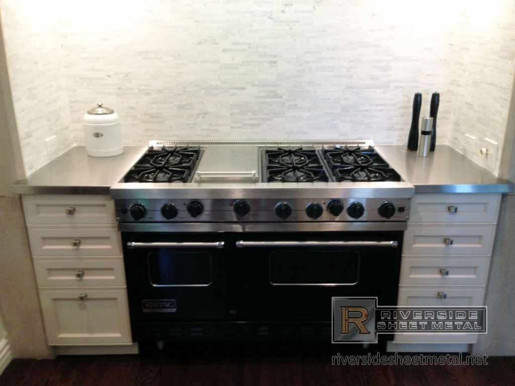 small number 4 finish stainless steel counter tops next to stove 1
