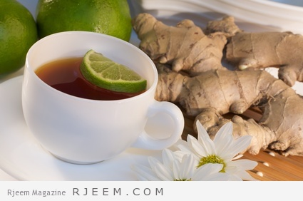 A cup of ginger tea with ingredients