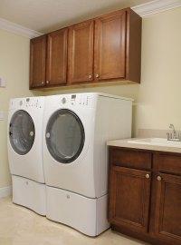 Laundry Room with Custom Cabinets + Sink - RJM Custom Homes