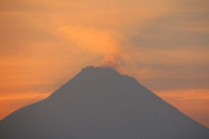 Smouldering Merapi volcano at sunrise, Central Java