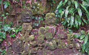 Ancient effigies seen along the Petanu River temple trek, Bali