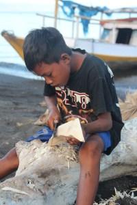 Sangeang Api boy carving, Sumbawa, Indonesia