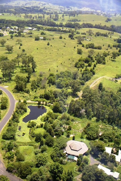 Training centre, orchard and dam at Djanbung Gardens, with Nimbin village in the distance