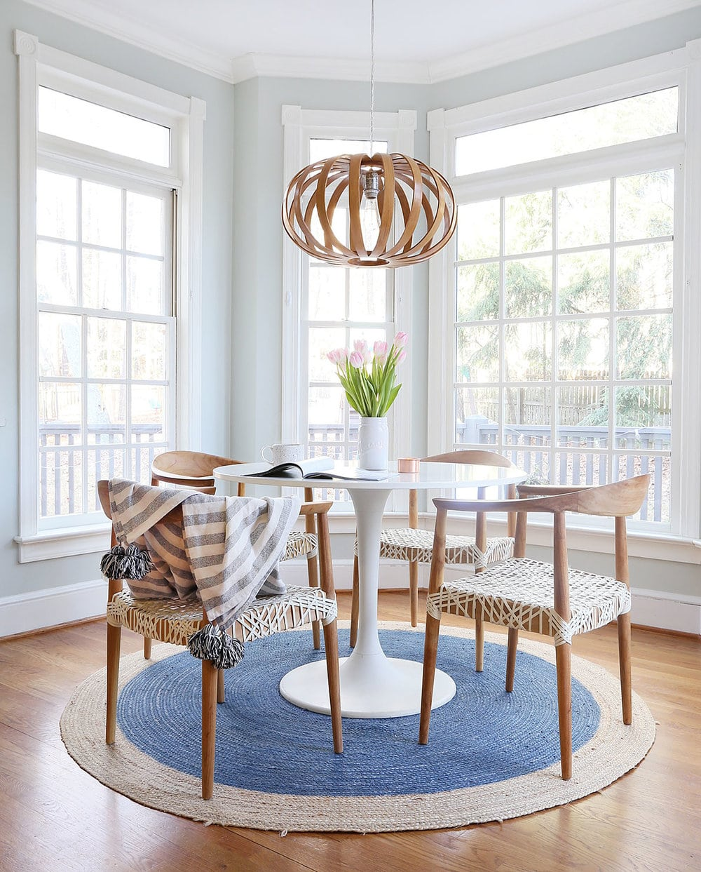 Mid-Century Design dinning room with string wrapped wood chairs
