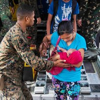U.S. Marine Lance Cpl. Xavier L. Cannon and members of the Philippine Armed Forces help civilians displaced by Typhoon Haiyan disembark a C-130 aircraft Nov. 13 at Villamor Air Base as part of Operation Damayan. The U.S. and Philippine Armed Forces have transported more than 107,000 pounds of relief supplies, 140 relief and aid workers, and more than 160 displaced personnel. The militaries of the two nations have partnered and trained together for decades, which prepare both forces for the challenges associated with extreme circumstances. Approximately 300 personnel from 3rd Marine Expeditionary Brigade have deployed in support of the relief efforts being orchestrated by the Government of the Philippines. (U.S. Marine Corps photo by Lance Cpl. Anne K. Henry/RELEASED)