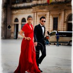 a young Italian couple dressed for a formal occasion walk thru Ortygia